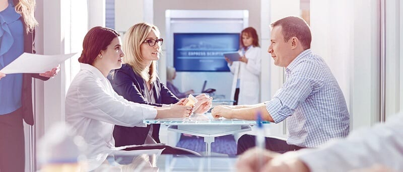 article_1_picture_2_two-women-and-a-man-in-business-meeting