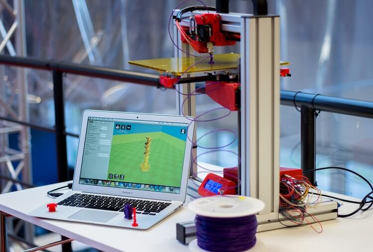 3D printer and laptop with 3D printing software